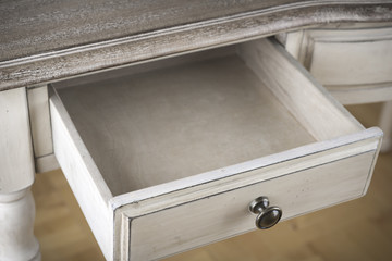 Open wooden drawer of vintage writing table - how to build a drawer