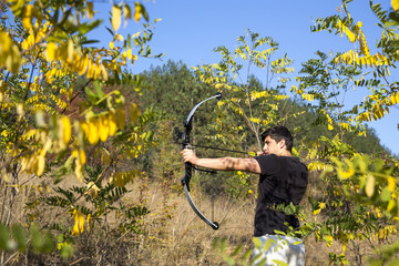 Archer draws his compound bow - how to make a recurve bow