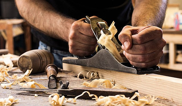 A Man Using a Right Hand Planes for Woodworks