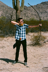 The Traditional Archer with a long bow in the desert - how to make a recurve bow