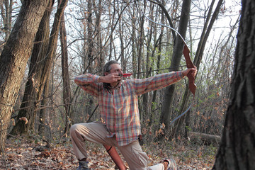 archer in the woods - how to make a recurve bow