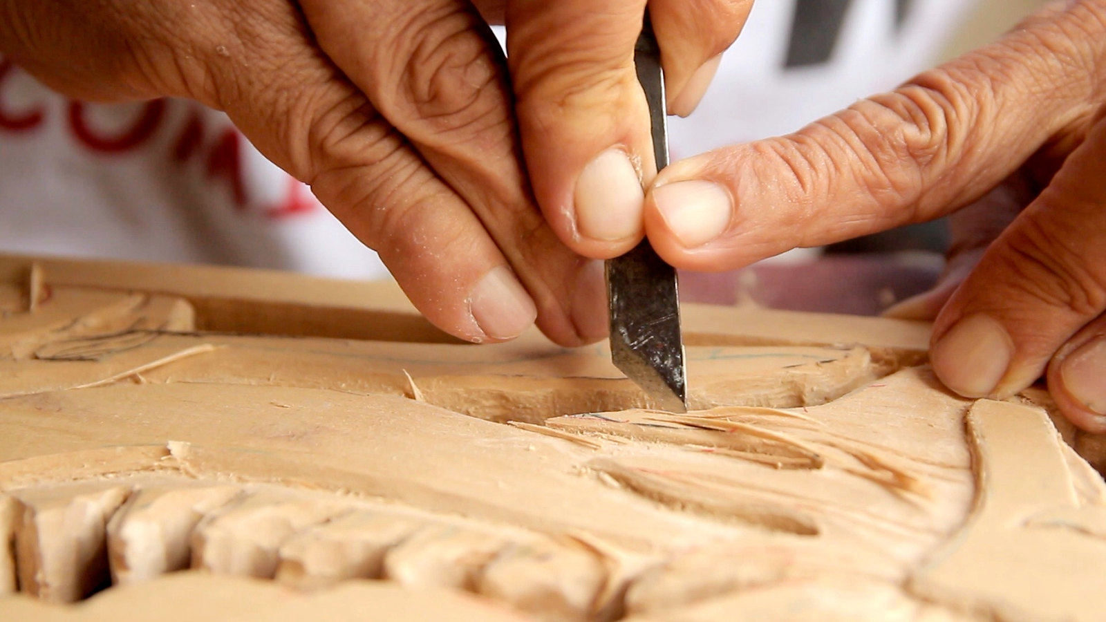 someone carving wood